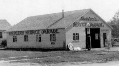 Albert Siebler's Service Garage in Loup City, Nebraska. Circa 1935